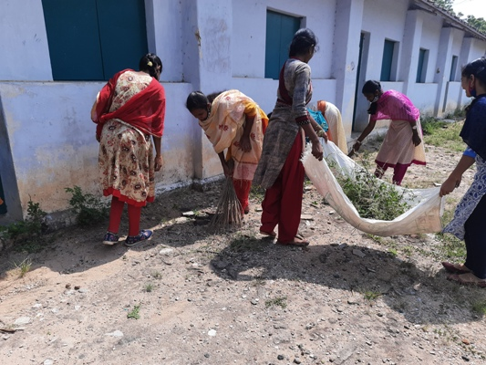 NSS Team removing the waste grass from the school surroundings